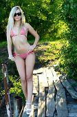 The beautiful woman the blonde in bikini