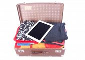 Vintage Leather Suitcase Overstuffed With Tablet Gadget