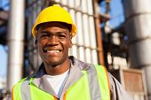 happy young african worker in petrochemical plant