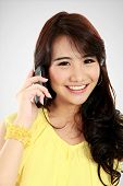 image of handphone  - closed up of young girl talking at the handphone - JPG