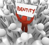 One person holds a sign or banner with the word Identity to spread awareness of his unique brand, qu
