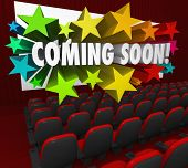 A movie theatre of red chairs and a screen with the words Coming Soon in 3d letters surrounded by co