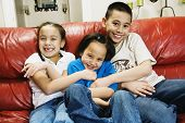 picture of tickle  - Asian siblings tickling sister - JPG