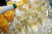 Pouring Champagne Into Flutes