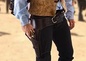 stock photo of gunslinger  - Gunman in the old wild west with studio lighting - JPG