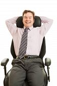 Happy Executive In Ergonomic Chair