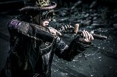 foto of dreadlocks  - Portrait of a steampunk man in the ruins - JPG
