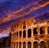 Bright crimson sunset over the ancient Colosseum. Rome. Italy