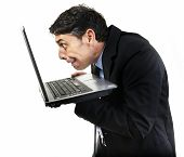 Humorous portrait of a furtive guilty man peering at x-rated content on his laptop computer with avi