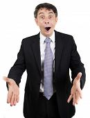 Overjoyed businessman with a pleased expression and his mouth open extending his hands in welcome, isolated on white