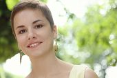 Outdoor portrait of young beautiful happy healthy smiling woman