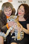 MOSCOW - OCT 22: Circus actress, animal trainer Karina Bagdasarova with tiger cub and soviet and rus