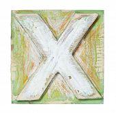 Wooden alphabet block, letter X