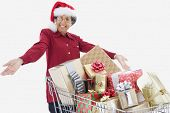 Senior woman with shopping cart full of gifts