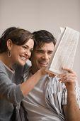 Couple looking at Zeitung Kleinanzeigen