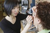 Make up artist performing makeover in salon