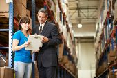 pic of warehouse  - Businessman And Female Worker In Distribution Warehouse - JPG