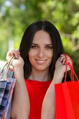 Young Woman with Shopping Bags Cose-Up
