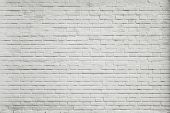 stock photo of motif  - Grungy textured white horizontal stone and brick paint architectural wall and floor inside old neglected and deserted interior - JPG