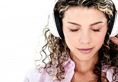 Woman with headphones listening to music - isolated over a white background