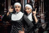 Attractive Young Nuns Posing In The Church