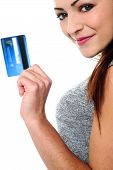 Fashionable Young Girl Holding Up A Credit Card