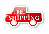 Red truck with a sign free shipping