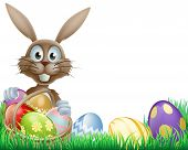 stock photo of wooden basket  - A cartoon Easter bunny rabbit with an Easter eggs basket - JPG