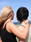 pic of gay couple  - Two young girls flirting in the sun - JPG