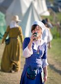 Grunwald - July 16: Medieval Fashion, Middle Ages Woman Having A Drink At Meeting At Battle Of Grunw