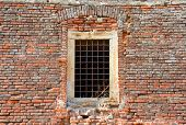 Medieval window on brick wall