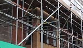 stock photo of scaffolding  - Scaffolding on a new housing building site - JPG