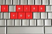 foto of miss you  - I miss you spelled on metallic keyboard - JPG
