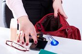Woman Packing Handbag