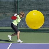 Pickleball Action - Senior Woman Hitting Backhand
