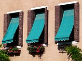Three Windows With Awnings In Venice