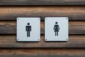 image of female toilet  - Man and a lady toilet sign metal on wood - JPG