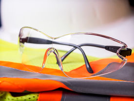 foto of ppe  - Construction safety equipment with glasses in front of hardhat - JPG