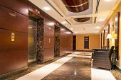 ABU DHABI, UAE - 31 MARCH 2014: Lobby and hall of The Grand Midwest Tower Hotel in Dubai, UAE. The G