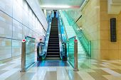 DUBAI, UAE - 31 MARCH 2014: Escalator in Dubai metro, UAE. The Dubai Metro is a driverless, fully au