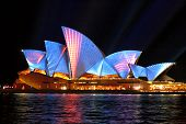 Sydney Opera Hosue Illuminated In Blue And Red Motion Strips