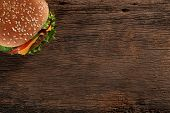 Tasty hamburger on wood background.
