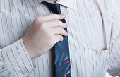 Hand Business Man Straightens His Tie