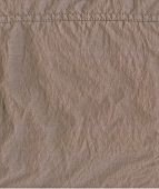 Texture Of Beige Raincoat Fabrics With A Seam As Background