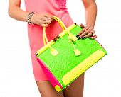stock photo of mini dress  - Closeup of woman with neon green and pink bag - JPG