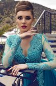Beautiful Woman With Elegant Hairstyle In Luxurious Silk Dress