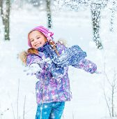 happy pretty  little girl outside in winter time
