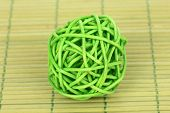 wicker bamboo ball on bamboo mat