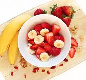Healthy breakfast with banana and strawberry mix