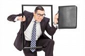 Businessman walking through a frame isolated against white background